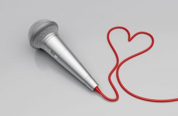 12163876 - music for love - concept image with microphone and heart shaped wire